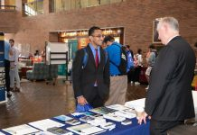 Lander University student Tanay Singh, a junior mathematics major and business minor from Columbia, speaks with a recruiter from the Federal Bureau of Investigations (FBI) during Lander's Graduate School & Career Fair on Wednesday, Oct. 10. Photo by Laura Brown.