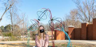"""Brianna Clayton, of Greenwood, won second place in the campus spirit category of the PBC Juried Art Exhibit, with a sculpture titled """"Don't Look Away."""" Clayton is a senior at Lander University. Photo by Laura Brown"""